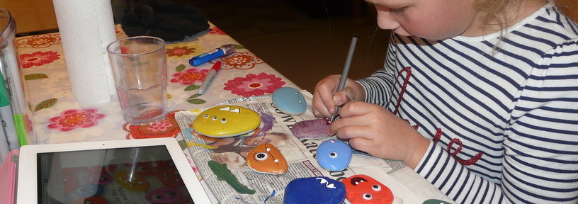 cute halloween pebble monsters at navigating by joy homeschool blog